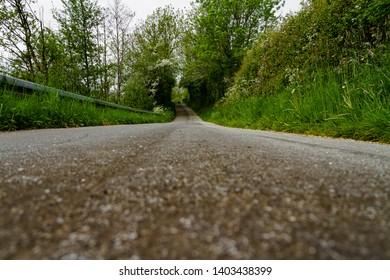 Rural asphalt road bending and curving.
