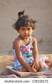 Rural baby girl on bed in the morning Salunkwadi, Beed, Maharashtra, India