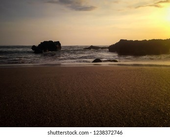 Rural Beach Scenery With The Sea Rocks In Sunset Light Of Batu Bolong Beach, Canggu Village, Badung, Bali, Indonesia