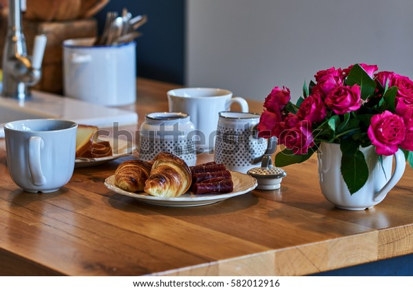 Rural breakfast with cup of coffee, croissant, homemade cheese and  jamon on rustic  wooden table.