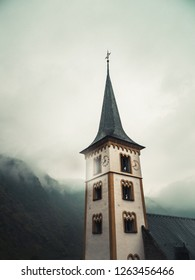 Rural church in the hills with clouds and rain