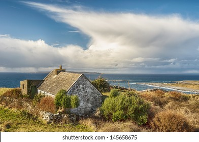 rural cottage in a scenic irish landscape. west ireland countryside landscape by the sea. stone cottage in rural ireland. scenic irish landscape background. on the wild atlantic way.