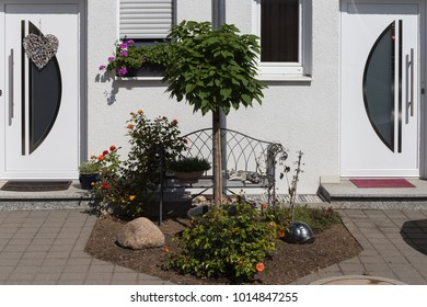 rural countryside house facades with garden decoration in south germany summer blue sky day
