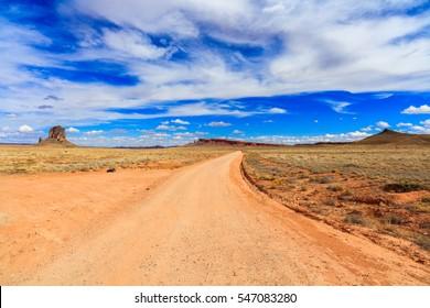 Rural dirt road in the Arizona desert.