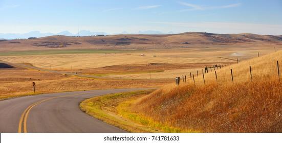 Rural drive through prairies in Alberta, Canada