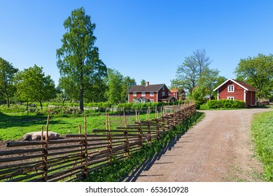 Rural environment with wooden fence beside the road