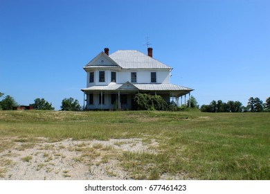 Rural farm land in small town Georgia with white house
