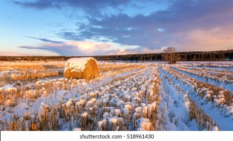 rural field with cut grass, a haystack and the first snow, Russia, Ural autumn