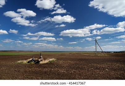 rural field in spring with the installation of irrigation,