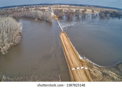 Rural Gravel Road in Big Sioux Recreation Area floods during spring melt