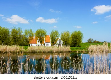 Rural houses by the canal between Bruges and Damme, West Flanders, Belgium