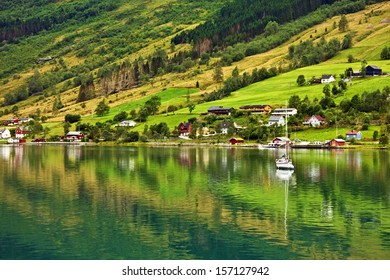 Rural houses and yacht in cruise port Olden in Cruise port Olden in Norwegian fjords, Norway.