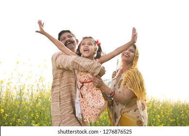 Rural Indian family having fun in agricultural field