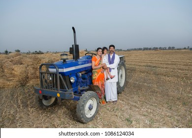 Rural indian Family Standing Together Near Tractor
