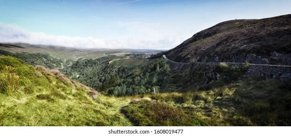 Rural Irish Country Road through Mountains