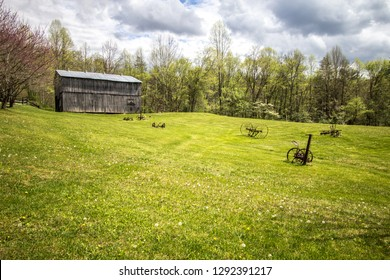 Rural Kentucky Farm. Old wooden barn and antique farm equipment.This is a historical structure on public parklands in the Daniel Boone National Forest. This is not a private property or residence.