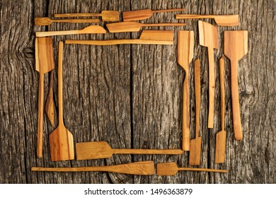 Rural kitchen utensils on vintage planked wood table from above - rustic background with free text space. Flat lay.