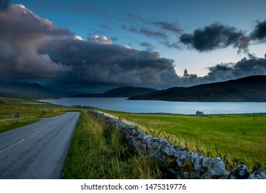 Rural Landscape With Abandoned Road And Remote House At The Atlantic Coast Of Scotland
