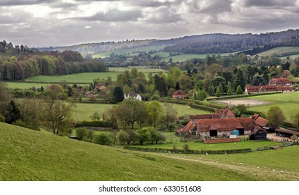 A Rural Landscape in the Chiltern Hills in England with grazing sheep and Farmhouse