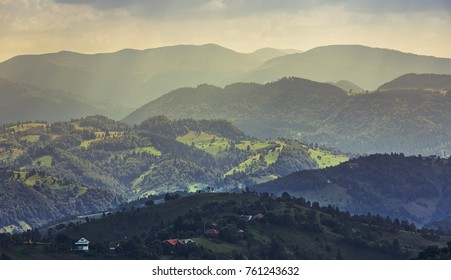 Rural landscape with early morning sunlight over the hills and valleys in Bran-Rucar pass, Brasov county, Transylvania, Romania.