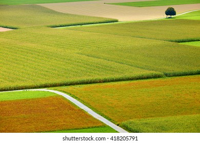 Rural landscape with fields and roads photographed from above in summer in Austria