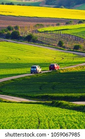Rural landscape with green fields, auto road and waves, South Moravia, Czech Republic