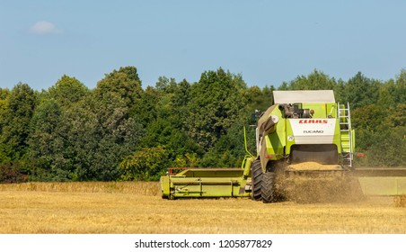 Rural landscape. Harvester in the process of harvesting grain crops. Wheat ripened. Harvest of cereals. crop, yield, plant, gather, crop, yield, plant, gather.   Naberezhnye Chelny 18,08,2018g