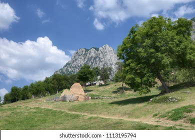 rural landscape with haystacks in mountains of Montenegro