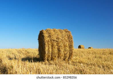 Rural landscape of haystacks on the field