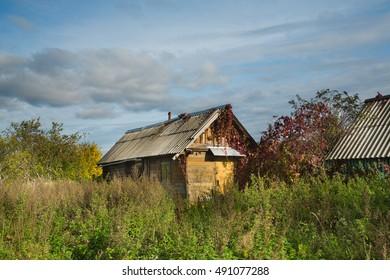 rural landscape, house, field, road, sky.