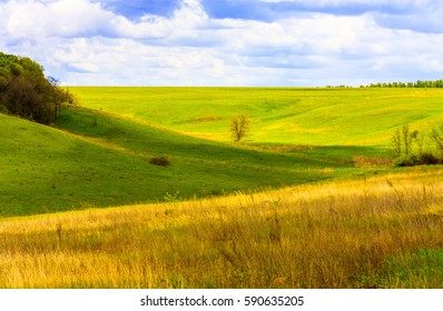 Rural landscape with meadow and sky