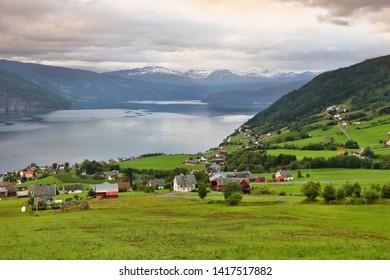 Rural landscape in Norway - cloudy Nordfjord view in Utvik.