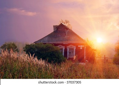 Rural landscape with old house in sunshine