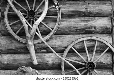 Rural landscape with old wooden wheels (background for message boards - concept)