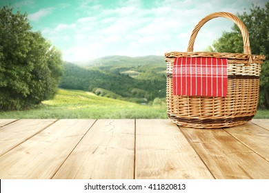 rural landscape and picnic basket and summer time