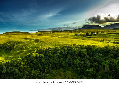Rural Landscape With Remote Houses At The Old Man Storr Formation On The Isle Of Skye In Scotland