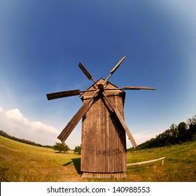 Rural landscape with retro windmill