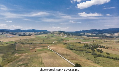 rural landscape with roads and fields in summer
