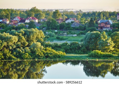 Rural landscape - village near the river in early morning. Birds eye view