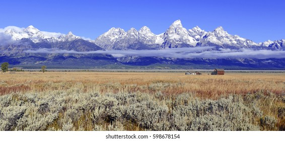 Rural Landscape with vintage barn and the Teton Range, Grand Teton National Park, Wyoming, USA