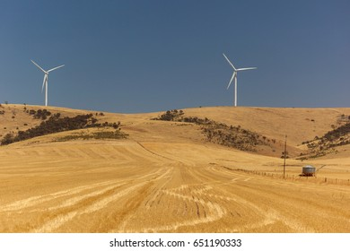 Rural landscape with wind generators distorted by hot air. South Australia