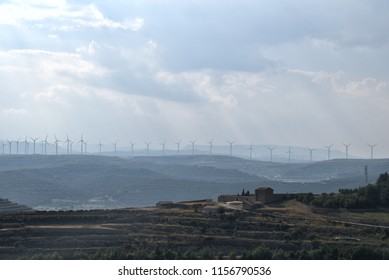 Rural landscape with windmills on background