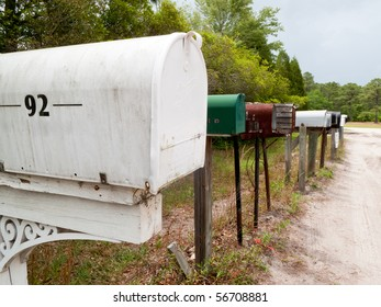 Rural mailboxes lined up along a dirt country road..