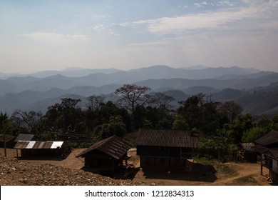 Rural makeshift hut in front of the jungle mountains on the country side in Laos