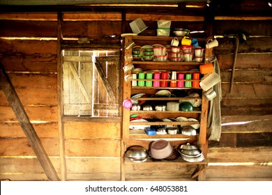 A Rural Makeshift Kitchen in Central America with Pots and Pans and Jars on a Shelf made with Wood