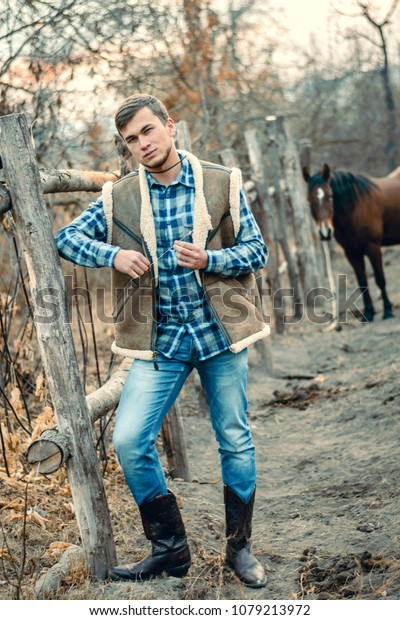 a7191f137b0 Rural Man Wearing Cowboy Boots Skirt Stock Photo (Edit Now) 1079213972