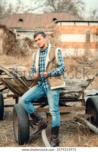 53a015514c3 Rural Man Wearing Cowboy Boots Skirt Stock Photo (Edit Now) 1079213975