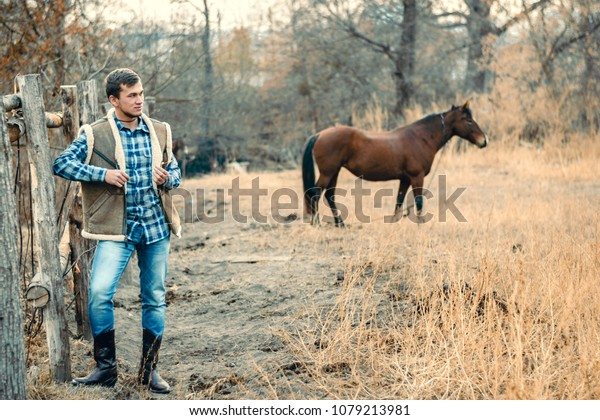 1595a6939ee Rural Man Wearing Cowboy Boots Skirt Stock Photo (Edit Now) 1079213981