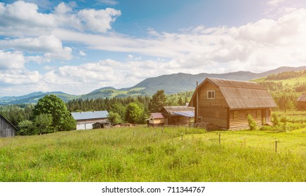 Rural mountain Landscape with wooden houses in ukraininan Carpathian