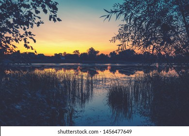 Rural nature landscape. Magical colorful sunset in countryside. Rural landscape in evening. Beautiful summer nature.